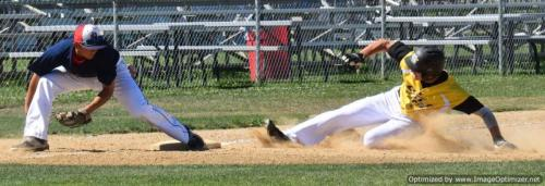 Austin Lively slides into third as Solano third baseman Kyle Paguio applies late tag in 9-run Colts first inning