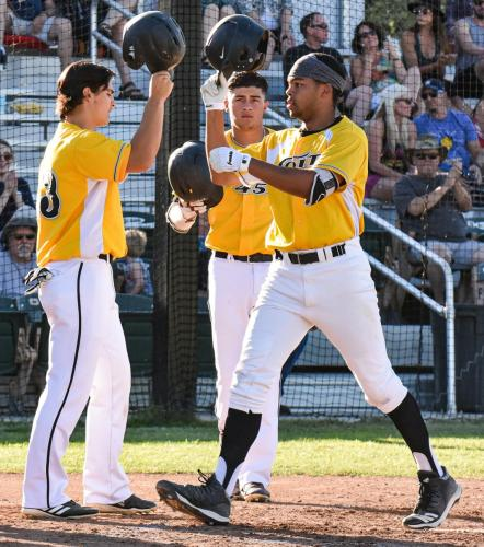 Colt 45s Christopher Brue, right, taps helmets with Tanner Tweedt after his two-run first inninghome Sunday night at Tiger field as Jakob Machuca, center, looks on