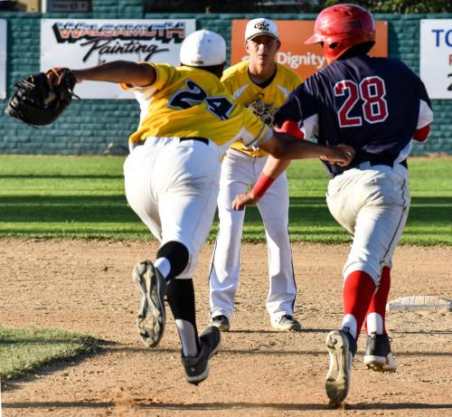 Colt 45s First Baseman Christopher Brue (24) lunges to tag out Fairfield's Andrew Shaw (28) after he was picked off and cazught in a run down Sunday night at Tiger Field. Connor McCoy looks on