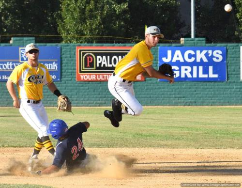 Colt 45s July 2 Austin Lively leaps over Fairfield's Jo Jo Quintanilla to complete second inning double play. Taylor Angl~1