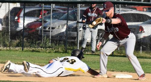 Colt 45s Tanner Tweedt dives back to first as Redding Ringtails first baseman John Downey takes the throw