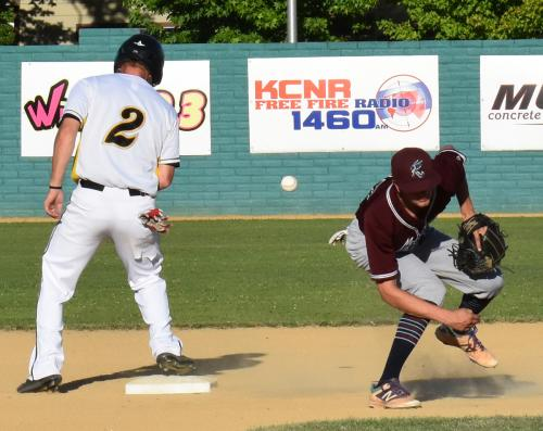 Colt 45s Tyler Thompson, 2, is safe at second Sunday night as the ball eludes Redding Ringtails shortstop Noah Otero