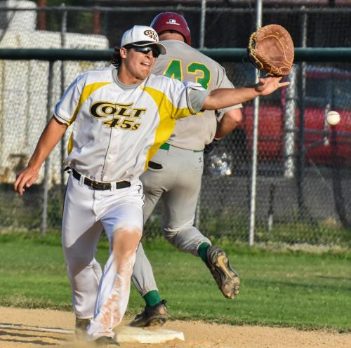 Colt 45s first baseman Tanner Tweedt grimaces as his glove flies after Santa Rosa's Jason Moran hit his arm as Tweedt reached for an errant throw Sunday night at Tiger Field