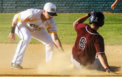 Colt 45s shortstop Brandon Roop tags out Redding Ringtails Jordan Taylor, 6, at second base in first inning of Sunday's game at Tiger Field